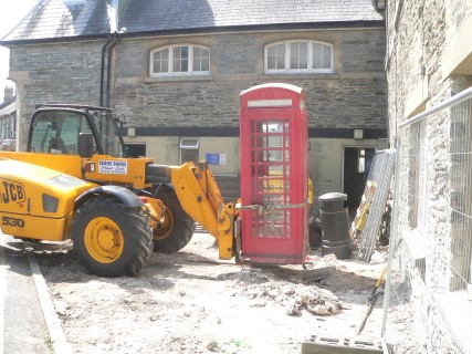 Moving the old red telephone box. It was put into storage.