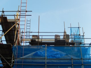 Tiles are removed from Cawdor Hall and the rafters can be seen.